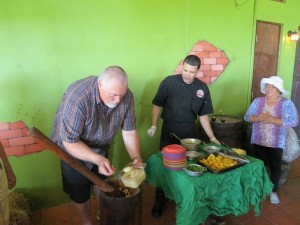 Robert Hazelrigg makes mofongo at cooking class
