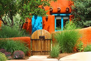 new-mexico-santa-fe-adobe-fence-and-cottage