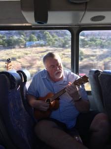 Robert plays guitar on bus